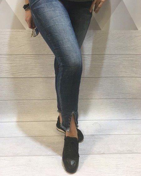 Jeansy z ozdobnymi nogawkami XL.