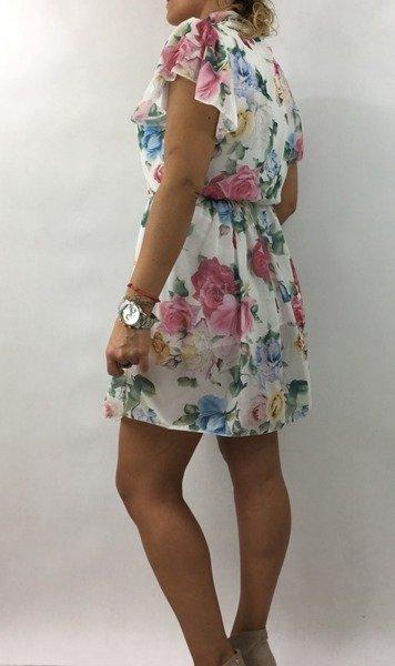 Sukienka w pastelowe kwiaty.
